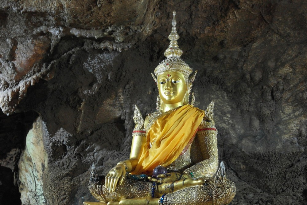 Several people showed their disrespect in a Buddhist cave in Thailand
